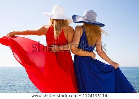 ストックフォト: Young Woman Wearing A Red Dress And Necklace