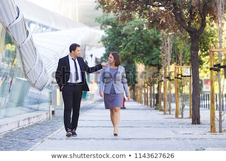 Businesswoman supporting with her shoulders Stock photo © AndreyPopov