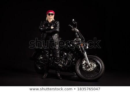 Attractive woman and the chopper in the background Stock photo © konradbak