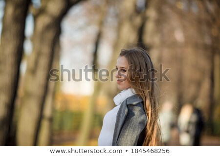 Stock photo: Young Woman with Brown Hair in Reverie