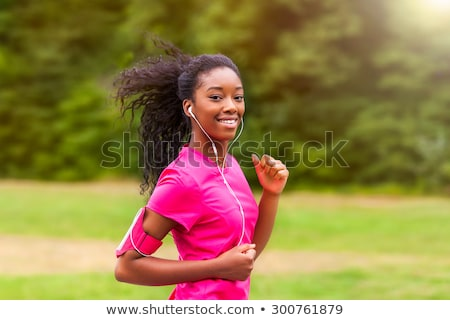 active young fit woman exercising with earphones stock photo © maridav