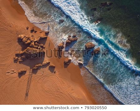 Vörös hajú nő tengerpart Newcastle Ausztrália reggel napfelkelte Stock fotó © jeayesy