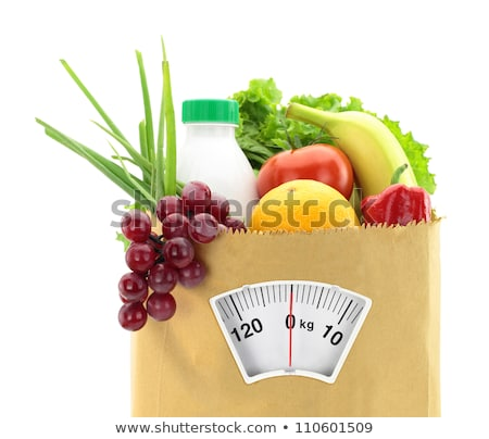 Mix of fruits on food scale Stock photo © fuzzbones0