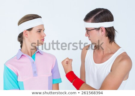 Geeky hipster showing fist to his girlfriend Stock photo © wavebreak_media