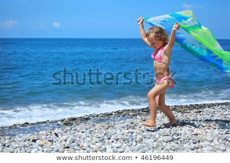 pretty little girl with fabric on stony seacoast lifted hands u stock photo © paha_l