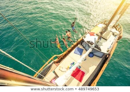 Man and woman jump above the sea stock photo © Paha_L