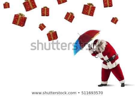 Vs prezenty burzy Święty mikołaj chroniony parasol Zdjęcia stock © alphaspirit