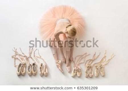 Blonde ballerina with pointe shoes Stock photo © bezikus
