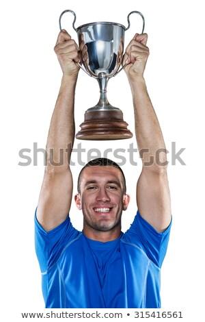 Kéz tart trófea fehér közelkép sport Stock fotó © wavebreak_media