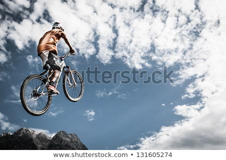 Teen boys on bikes jumping Stock photo © IS2
