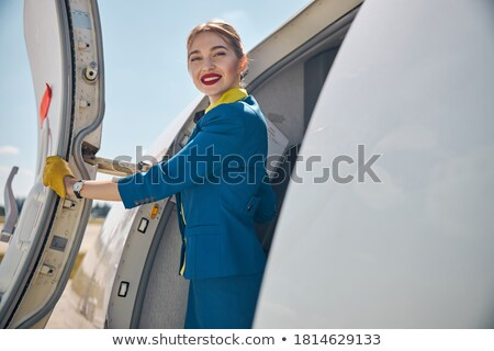 Flight personnel smiling Stock photo © IS2