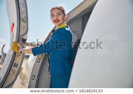 полет персонал улыбаясь женщину книга ноутбук Сток-фото © IS2