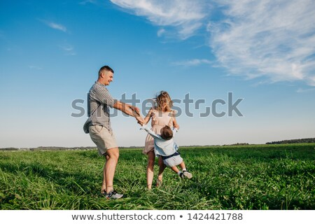father swinging son in meadow Stock photo © IS2