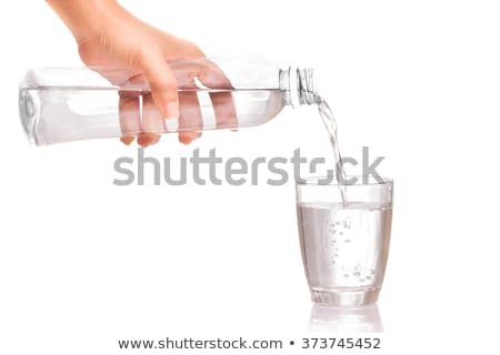 Woman pouring water into glass Stock photo © IS2