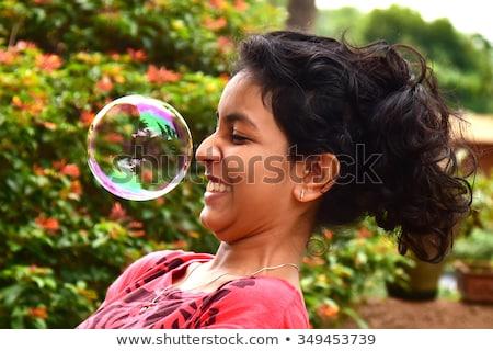 Nagy nő buborékfújás nevet buborék szabadidő Stock fotó © IS2