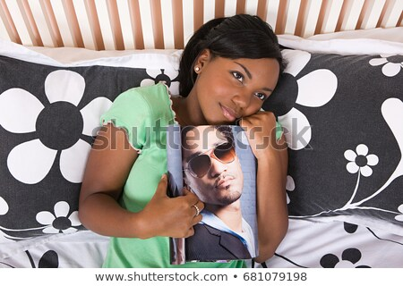 Teenager hugging a photo of her idol Stock photo © IS2