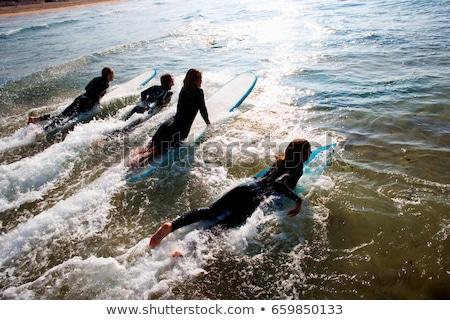 Négy személy szörfdeszkák víz szabadság mosolyog szörfös Stock fotó © IS2