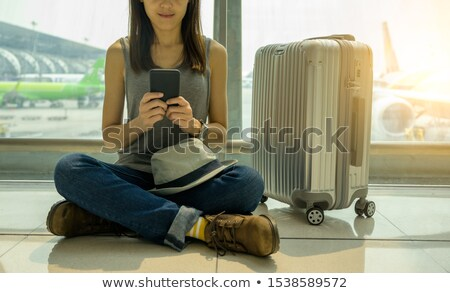 close up of woman sitting in plane with smartphone Stock photo © dolgachov