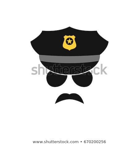 Policeman in black and white uniform Stock photo © colematt