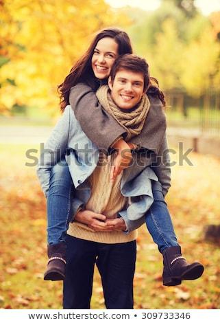 glimlachend · paar · najaar · park · liefde - stockfoto © dolgachov