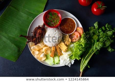 nasi lemak kukus with quail meat stock photo © szefei