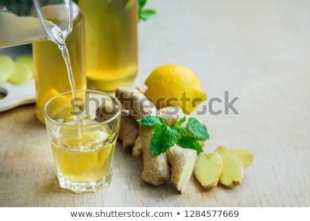 Detox water in bottles with ingredients, ginger, lemon, mint Stockfoto © Illia