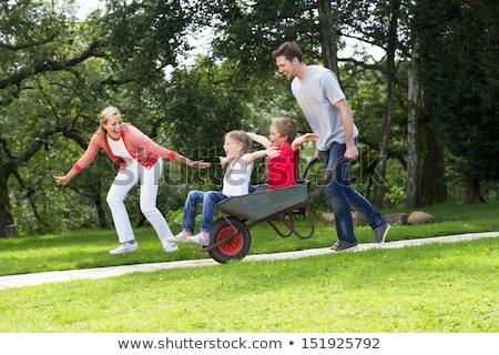 ouders · kinderen · kruiwagen · familie · glimlach · man - stockfoto © monkey_business