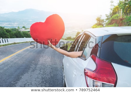 Relaxed happy traveler, Young beatiful asian gilr holding red he Stock photo © Freedomz