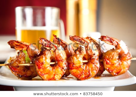 Beer snacks. Grilled shrimps Stock photo © karandaev