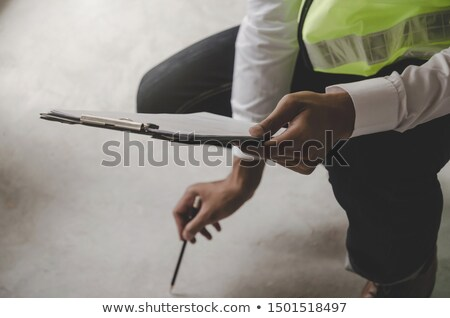 Construction worker completing the interior Stock photo © Kzenon