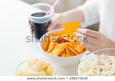 Femme manger maïs nachos Cola Photo stock © dolgachov