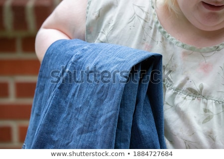 Washed blue jeans drying outside Stock photo © artush