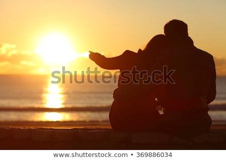 çift seven kucaklamak oturma güneş adam Stok fotoğraf © photography33