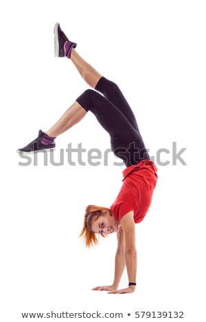 flexible girl standing on one hand Stock photo © dacasdo