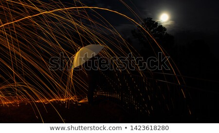 woman with umbrella over full moon background stock photo © konradbak