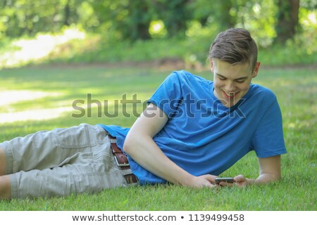 casual fashion man laughing while laying down stock photo © feedough
