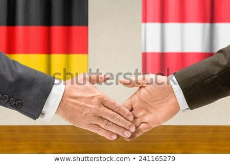Alemanha Áustria apertar a mão negócio mãos sucesso Foto stock © Zerbor
