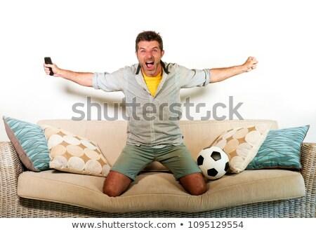 Futball ventillátor ugrik kanapé éljenez otthon Stock fotó © wavebreak_media