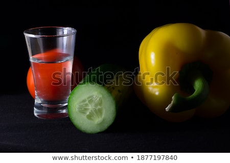 Glass of vodka with pepper and lime slice isolated on white Stock photo © tetkoren