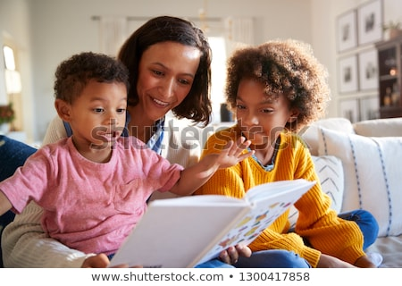 Young Boy Reads to His Mother and Sister Stock photo © feverpitch