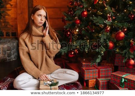 Woman talking on the mobile phone on Christmas eve Stock photo © stevanovicigor