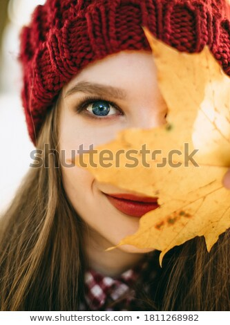 blue-eyed blond in the park in autumn with yellow leaves Stock photo © Paha_L