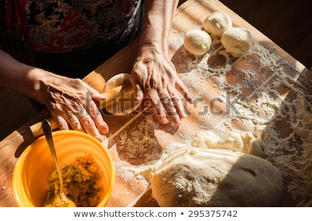 wrinkled hands of an old woman on a table Stock photo © Giulio_Fornasar