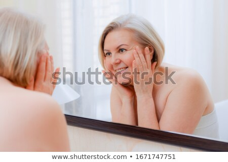 lady looks in a mirror Stock photo © ssuaphoto