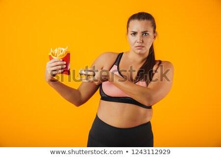 afbeelding · ernstig · te · zwaar · vrouw · trainingspak · stoppen - stockfoto © deandrobot