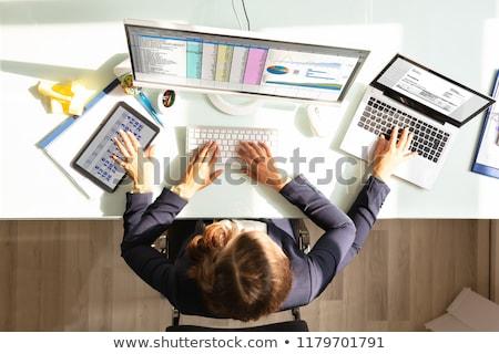 üzletember multitaszking munka kilátás munkahely üzlet Stock fotó © AndreyPopov