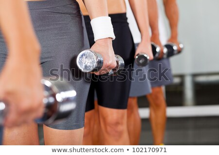 Man And Woman's Hand Holding Dumbbell Stock photo © AndreyPopov