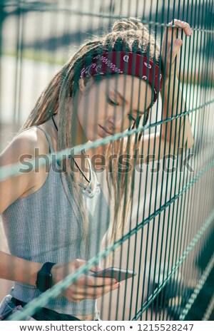 güzel · genç · kadın · ayakta · zincir · bağlantı · çit - stok fotoğraf © lopolo