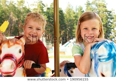 Girls in Park on Swing, Playground and Ice Cream Stock photo © robuart