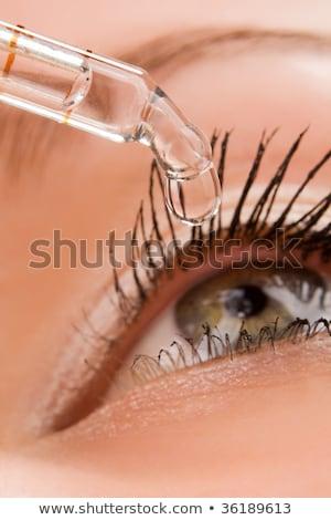 Closeup of eyedropper putting liquid into open eye Stock photo © galitskaya